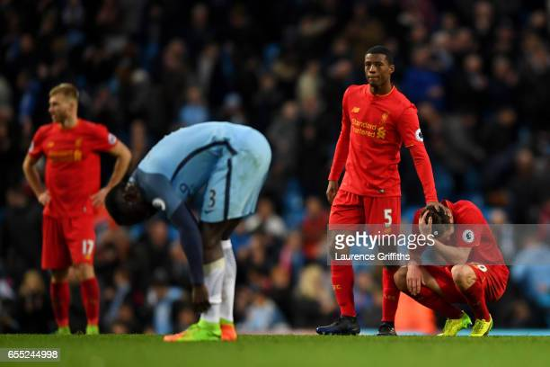 Georginio Wijnaldum of Liverpool pats Adam Lallana of Liverpool on the back after the Premier League match between Manchester City and Liverpool at...