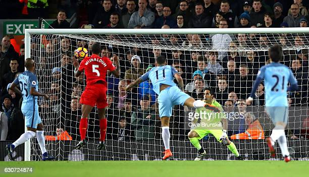 Georginio Wijnaldum of Liverpool scores his sides first goal during the Premier League match between Liverpool and Manchester City at Anfield on...