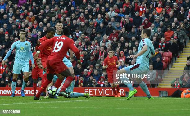 Georginio Wijnaldum of Liverpool Scores Liverpools Equiliser during the Premier League match between Liverpool and Burnley at Anfield on March 12...