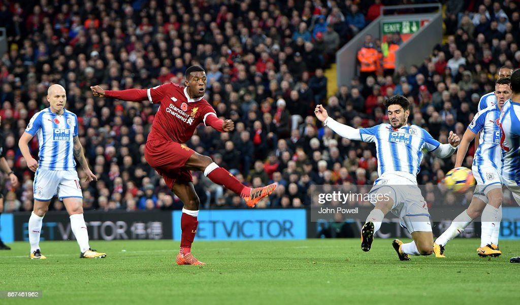 Georginio Wijnaldum of Liverpool scores the third goal during the Premier League match between Liverpool and Huddersfield Town at Anfield on October 28, 2017 in Liverpool, England.