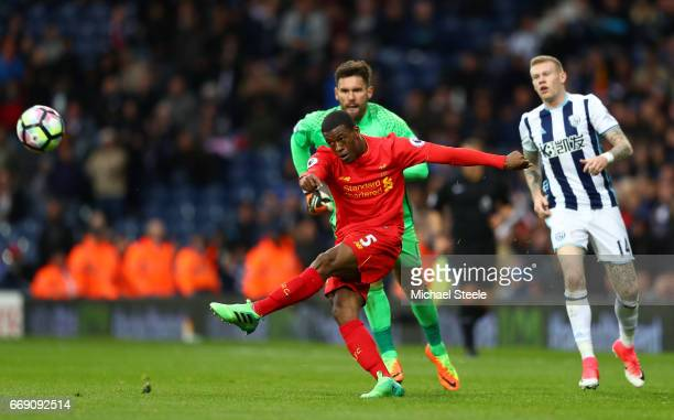 Georginio Wijnaldum of Liverpool shoots as Ben Foster of West Bromwich Albion attempts to scramble back to stop him during the Premier League match...