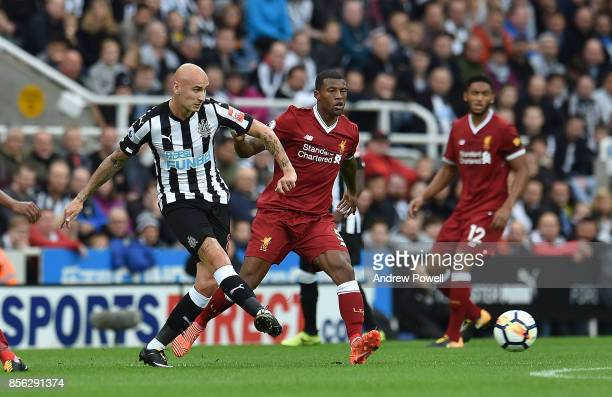 Georginio Wijnaldum of Liverpool with Jonjo Shelvey of newcastle during the Premier League match between Newcastle United and Liverpool at St James...