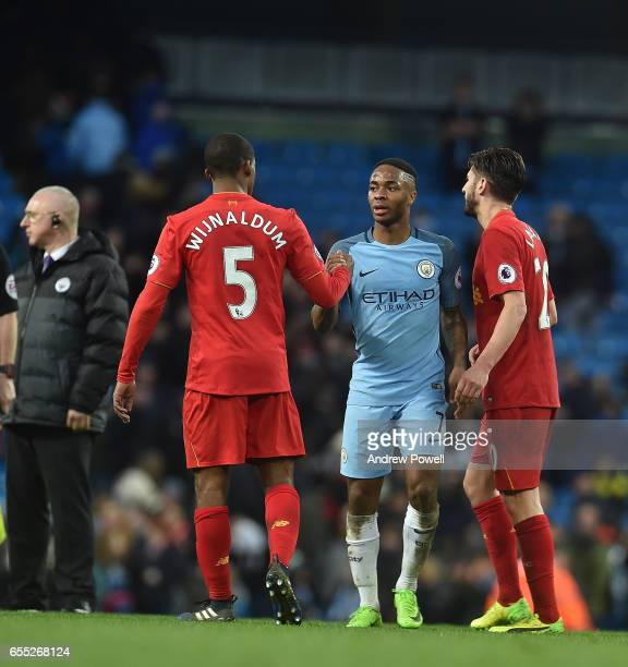 Georginio Wijnaldum of Liverpool with Raheem Sterling at the end of the Premier League match between Manchester City and Liverpool at Etihad Stadium...