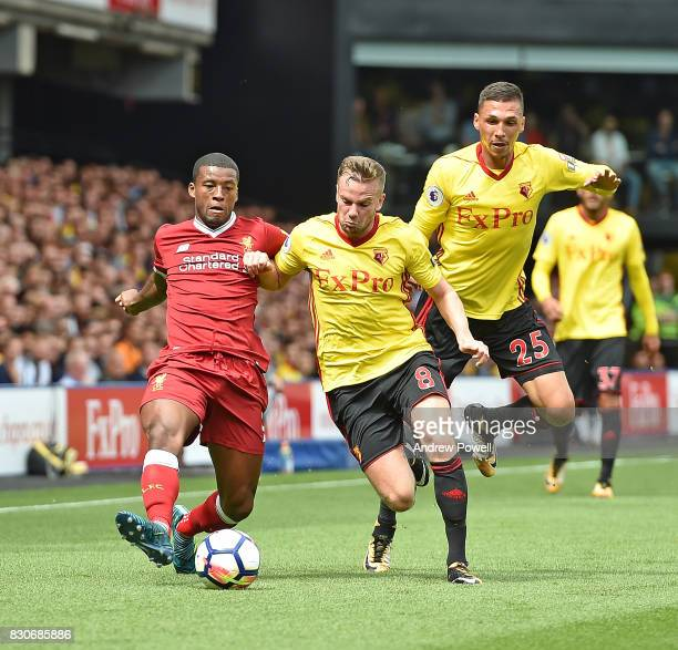 Georginio Wijnaldum of Liverpool with Tom Cleverley during the Premier League match between Watford and Liverpool at Vicarage Road on August 12 2017...