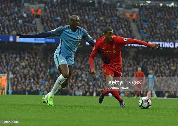 Georginio Wijnaldum of Liverpool with YaYa Toure of Man City during the Premier League match between Manchester City and Liverpool at Etihad Stadium...