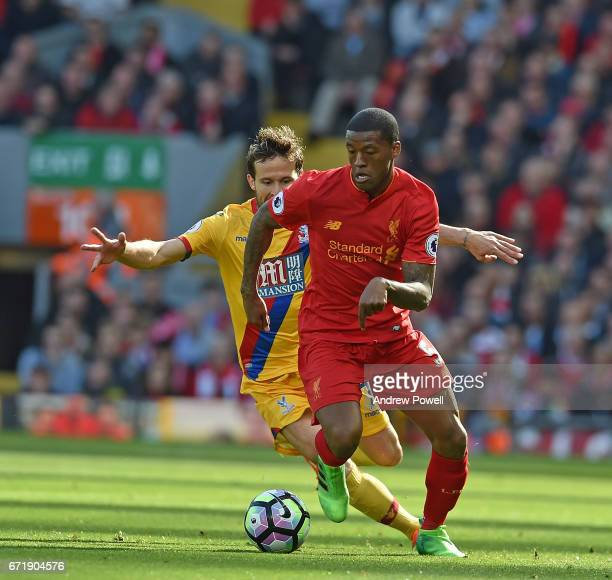 Georginio Wijnaldum of Liverpool with Yohan Cabaye of crystal palace during the Premier League match between Liverpool and Crystal Palace at Anfield...