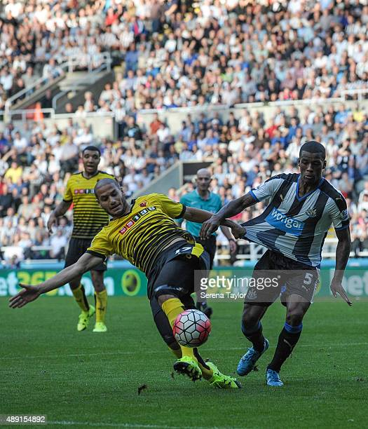 Georginio Wijnaldum of Newcastle and Adlene Guedioura of Watford tousle for the ball during the Barclays Premier League match between Newcastle...