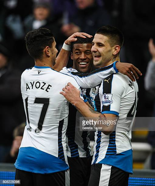 Georginio Wijnaldum of Newcastle celebrates with teammates Aleksandar Mitrovic and Ayoze Perez after scoring their second goal during the Barclays...