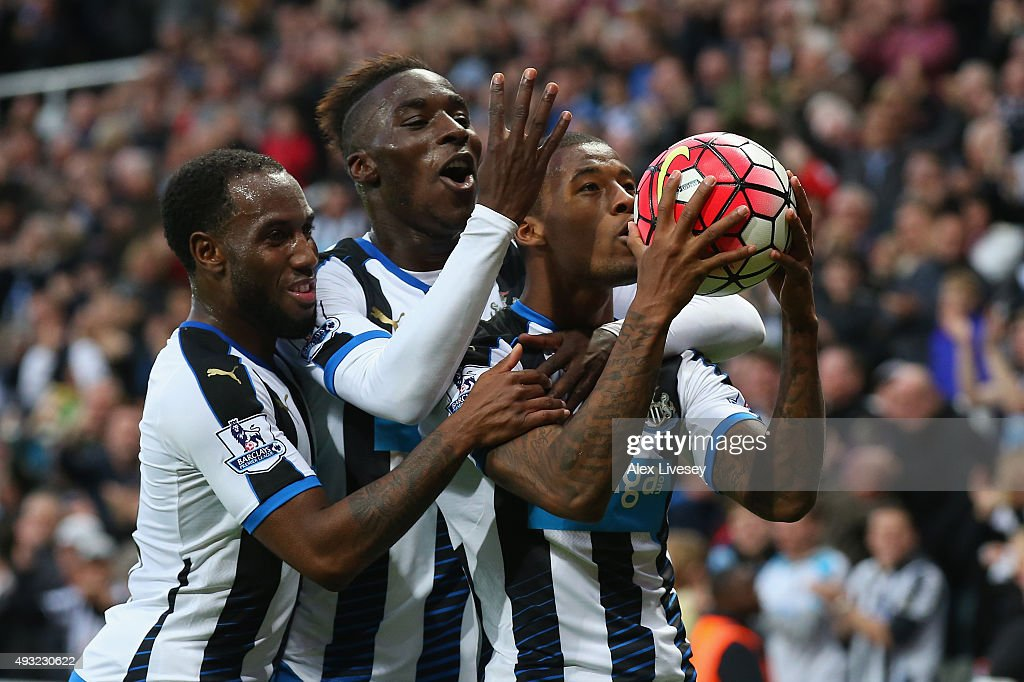 Georginio Wijnaldum of Newcastle United (R) celebrates as he scores their sixth goal and his fourth with Vurnon Anita (L) and Massadio Haidara (C) during the Barclays Premier League match between Newcastle United and Norwich City at St James' Park on October 18, 2015 in Newcastle upon Tyne, England.