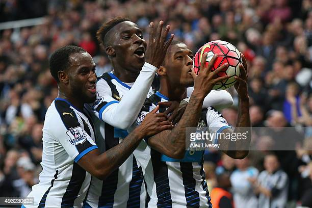Georginio Wijnaldum of Newcastle United celebrates as he scores their sixth goal and his fourth with Vurnon Anita and Massadio Haidara during the...