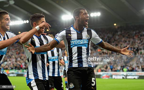 Georginio Wijnaldum of Newcastle United celebrates scoring his team's second goal with his team mates during the Barclays Premier League match...