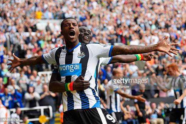 Georginio Wijnaldum of Newcastle United celebrates scoring their second goal with Papiss Demba Cisse of Newcastle United during the Barclays Premier...