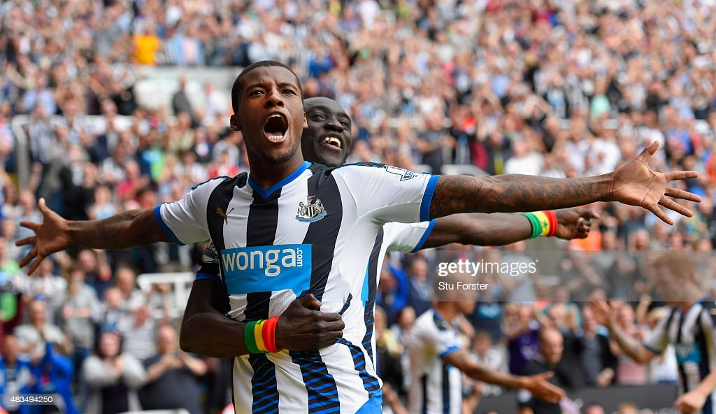 Georginio Wijnaldum of Newcastle United (l)celebrates scoring their second goal with Papiss Demba Cisse of Newcastle United during the Barclays Premier League match between Newcastle United and Southampton at St James Park on August 9, 2015 in Newcastle, England.