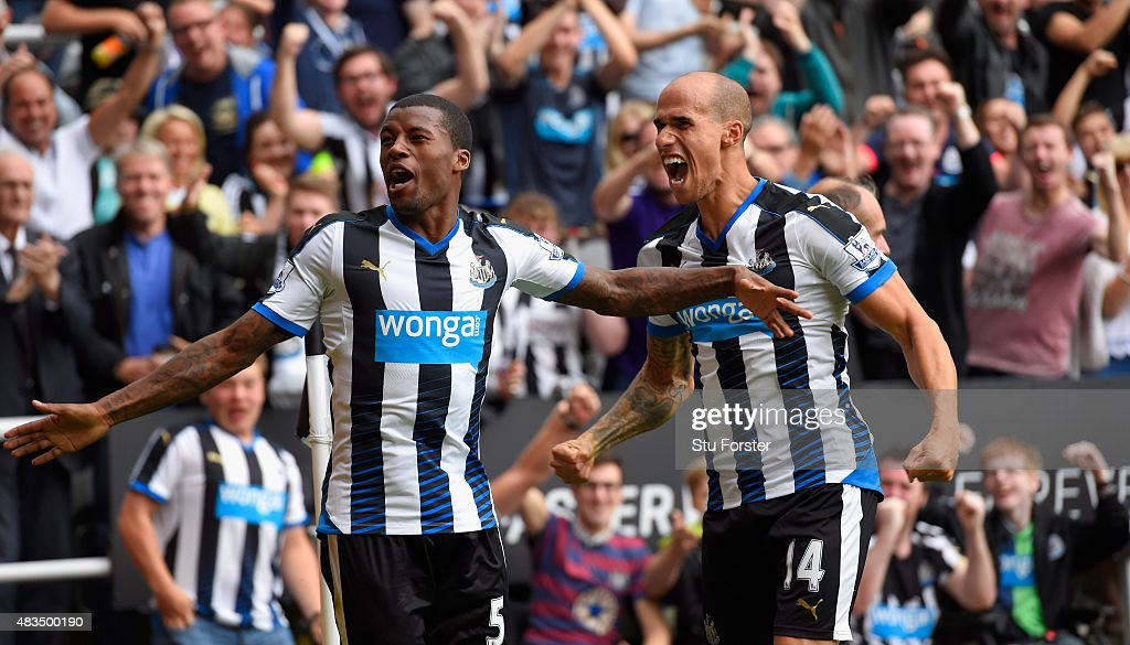 Georginio Wijnaldum of Newcastle United (l)celebrates scoring their second goal with Gabriel Obertan of Newcastle United during the Barclays Premier League match between Newcastle United and Southampton at St James Park on August 9, 2015 in Newcastle, England.