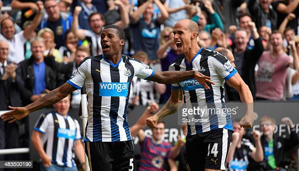 Georginio Wijnaldum of Newcastle United celebrates scoring their second goal with Gabriel Obertan of Newcastle United during the Barclays Premier...