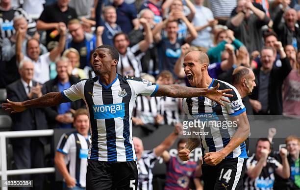 Georginio Wijnaldum of Newcastle United celebrates scoring their second goal with Gabriel Obertan during the Barclays Premier League match between...