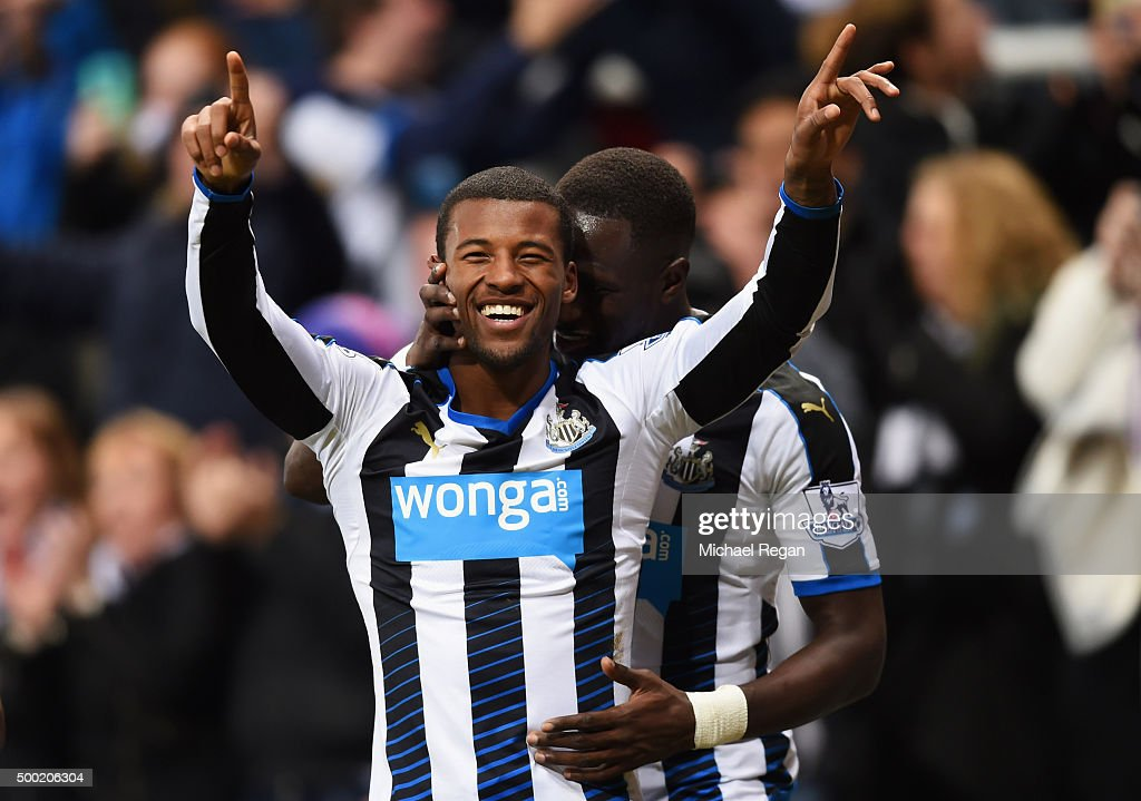 Georginio Wijnaldum of Newcastle United (L) celebrates with Moussa Sissoko as he scores their second goal during the Barclays Premier League match between Newcastle United and Liverpool at St James' Park on December 6, 2015 in Newcastle upon Tyne, England