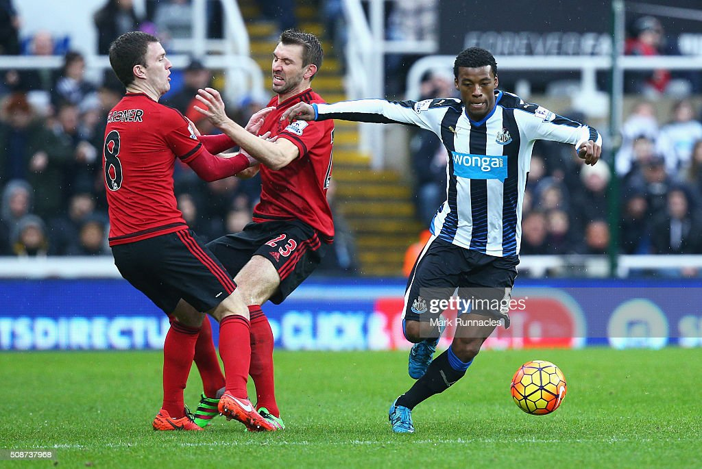 <a gi-track='captionPersonalityLinkClicked' href=/galleries/search?phrase=Georginio+Wijnaldum&family=editorial&specificpeople=2146603 ng-click='$event.stopPropagation()'>Georginio Wijnaldum</a> of Newcastle United evades <a gi-track='captionPersonalityLinkClicked' href=/galleries/search?phrase=Craig+Gardner&family=editorial&specificpeople=685283 ng-click='$event.stopPropagation()'>Craig Gardner</a> (8) and Gareth McAuley of West Bromwich Albion during the Barclays Premier League match between Newcastle United and West Bromwich Albion at St James' Park on February 6, 2016 in Newcastle upon Tyne, England.