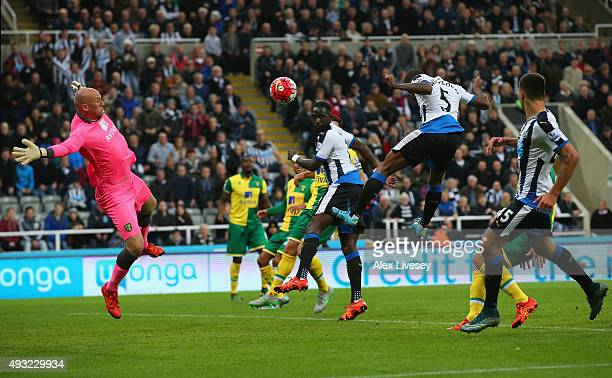 Georginio Wijnaldum of Newcastle United heads in their fifth goal past John Ruddy of Norwich City to complete his hat trick during the Barclays...