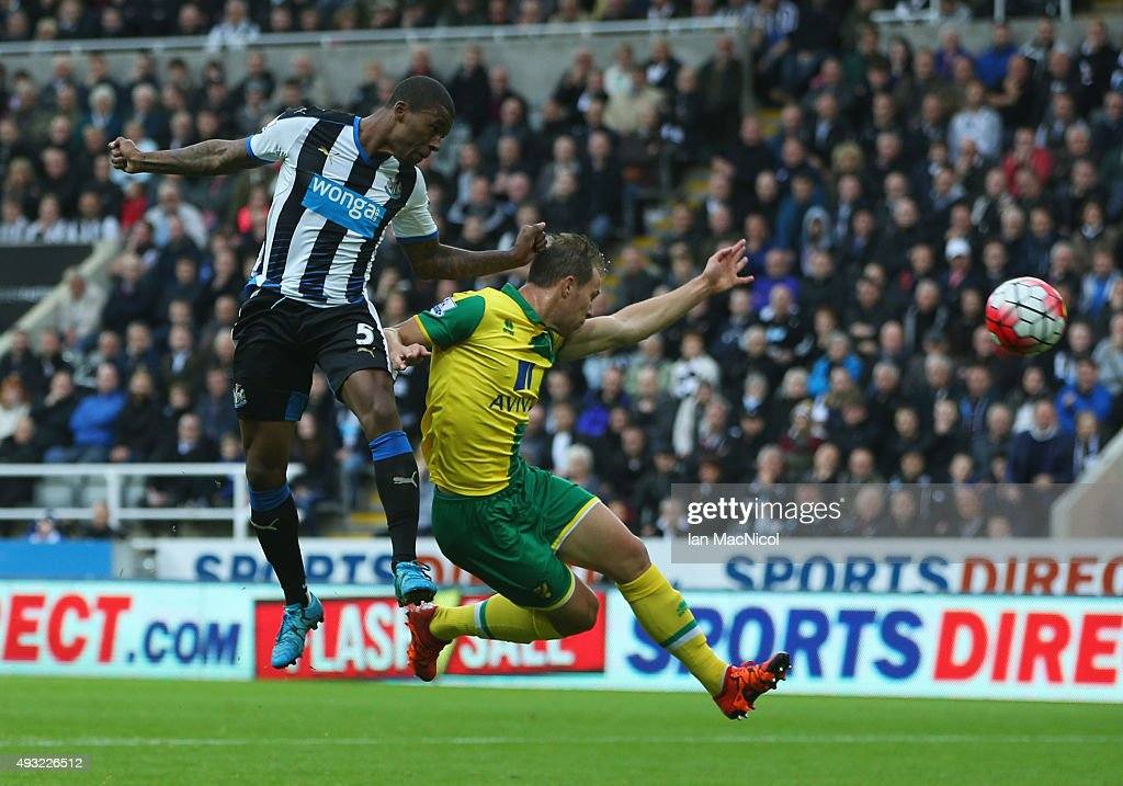 Georginio Wijnaldum of Newcastle United outjumps Steven Whittaker of Norwich City to score their second goal during the Barclays Premier League match between Newcastle United and Norwich City at St James' Park on October 18, 2015 in Newcastle upon Tyne, England.