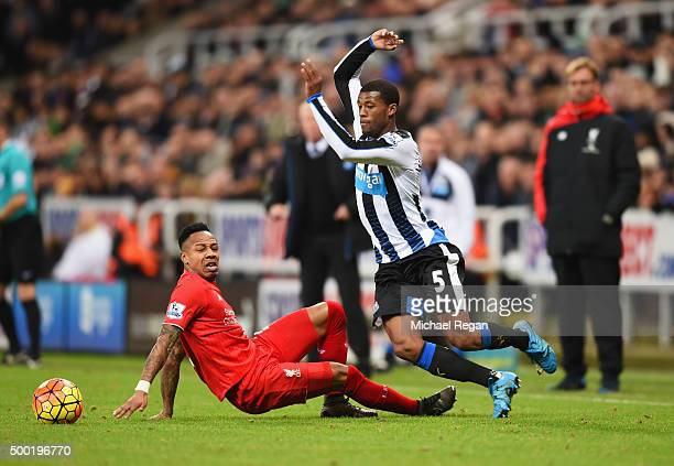 Georginio Wijnaldum of Newcastle United skips past Nathaniel Clyne of Liverpool during the Barclays Premier League match between Newcastle United and...
