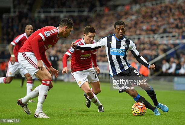 Georginio Wijnaldum of Newcastle United takes on Ander Herrera and Chris Smalling of Manchester United during the Barclays Premier League match...