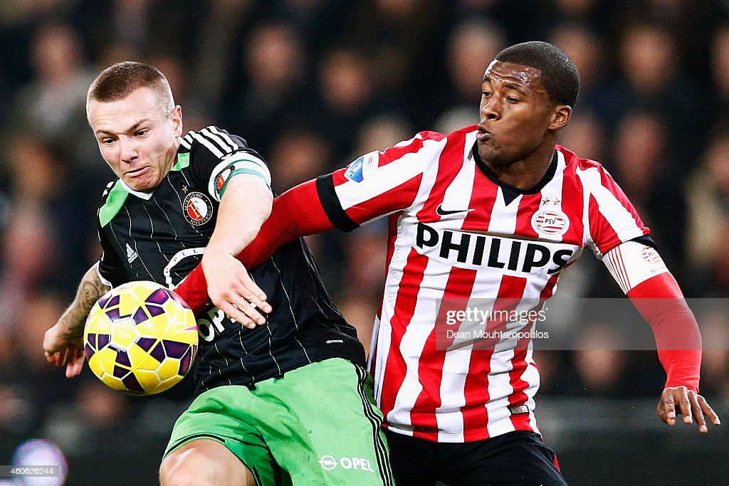 <a gi-track='captionPersonalityLinkClicked' href=/galleries/search?phrase=Georginio+Wijnaldum&family=editorial&specificpeople=2146603 ng-click='$event.stopPropagation()'>Georginio Wijnaldum</a> of PSV and <a gi-track='captionPersonalityLinkClicked' href=/galleries/search?phrase=Jordy+Clasie&family=editorial&specificpeople=7012011 ng-click='$event.stopPropagation()'>Jordy Clasie</a> of Feyenoord battle for the ball during the Eredivisie match between PSV Eindhoven and Feyenoord Rotterdam held at the Philips Stadion on December 17, 2014 in Eindhoven, Netherlands.