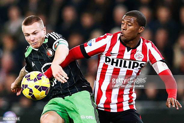 Georginio Wijnaldum of PSV and Jordy Clasie of Feyenoord battle for the ball during the Eredivisie match between PSV Eindhoven and Feyenoord...