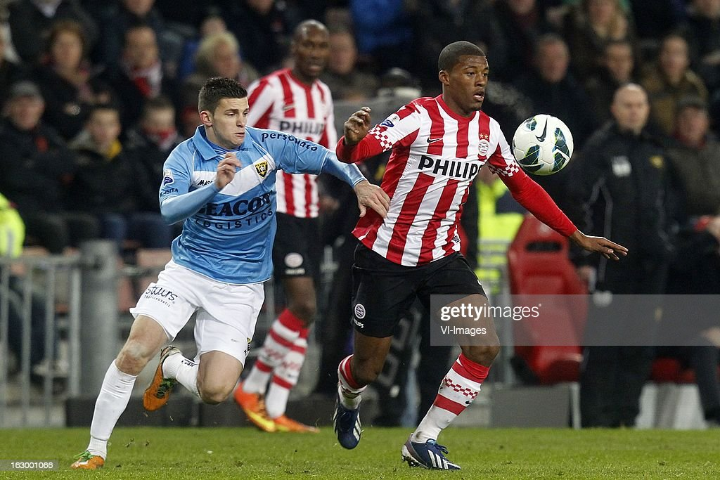 Georginio Wijnaldum of PSV (R), Bryan Linssen of VVV-Venlo (L) during the Dutch Eredivisie match between PSV Eindhoven and VVV-Venlo at Philips Stadium on march 02, 2013 in Eindhoven, The Netherlands