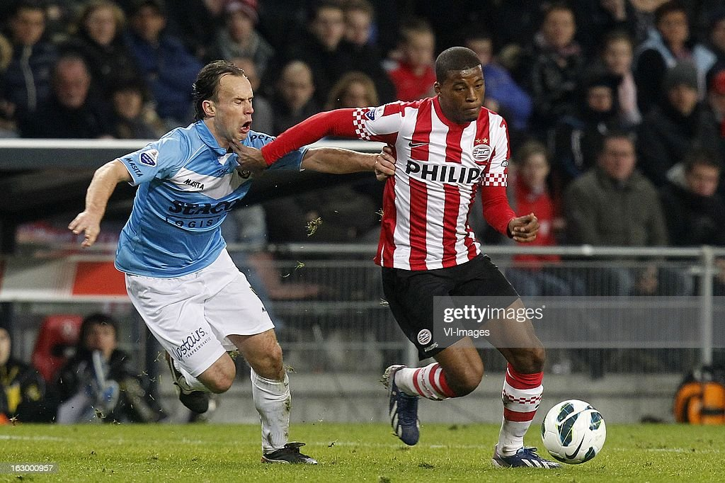 Georginio Wijnaldum of PSV (R), Niels Fleuren of VVV-Venlo (L) during the Dutch Eredivisie match between PSV Eindhoven and VVV-Venlo at Philips Stadium on march 02, 2013 in Eindhoven, The Netherlands