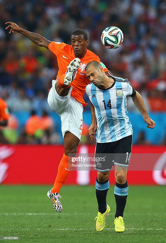 Georginio Wijnaldum of the Netherlands and Javier Mascherano of Argentina compete for the ball during the 2014 FIFA World Cup Brazil Semi Final match between the Netherlands and Argentina at Arena de Sao Paulo on July 9, 2014 in Sao Paulo, Brazil.