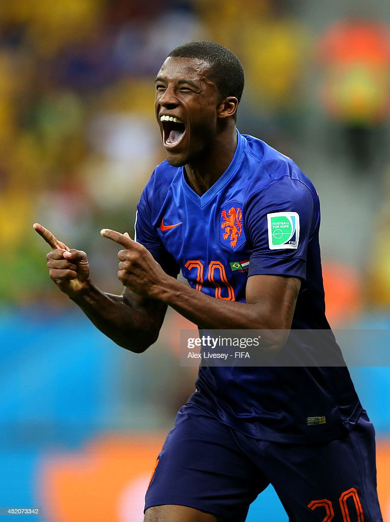 Georginio Wijnaldum of the Netherlands celebrates scoring his team's third goal during the 2014 FIFA World Cup Brazil 3rd Place Playoff match between Brazil and Netherlands at Estadio Nacional on July 12, 2014 in Brasilia, Brazil.