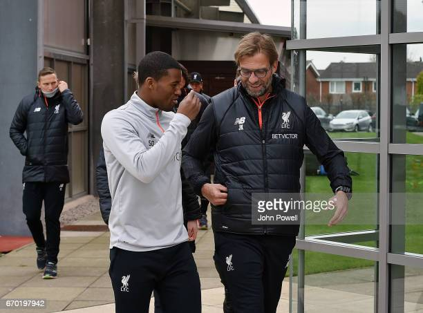 Georginio Wijnaldum talking with Jurgen Klopp manager of Liverpool during a training session at Melwood Training Ground on April 19 2017 in Liverpool...