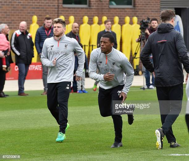 Georginio Wijnaldum with Alberto Moreno of Liverpool during a training session at Melwood Training Ground on April 19 2017 in Liverpool England