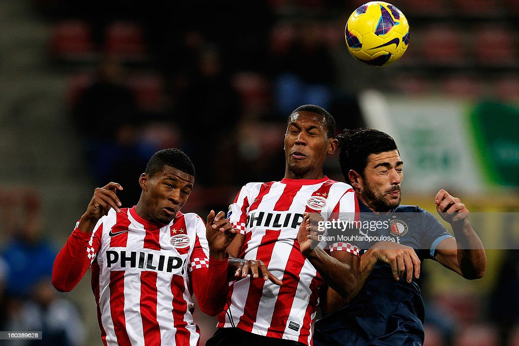 Georgino Wijnaldum and Marcelo Antonio Guedes Filho of PSV and Graziano Pelle of Feyenoord battle for the header during the KNVB Dutch Cup match between PSV Eindhoven and Feyenoord Rotterdam at Philips Stadion on January 30, 2013 in Eindhoven, Netherlands.
