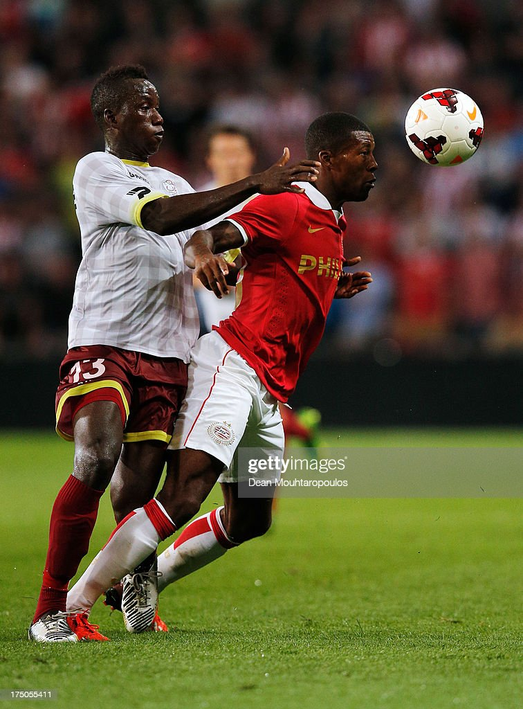 Georgino Wijnaldum of PSV and Mamatou N'Diaye of Zulte Waregem battle for the ball during the First Leg 3rd Qualifying Round UEFA Champions League...