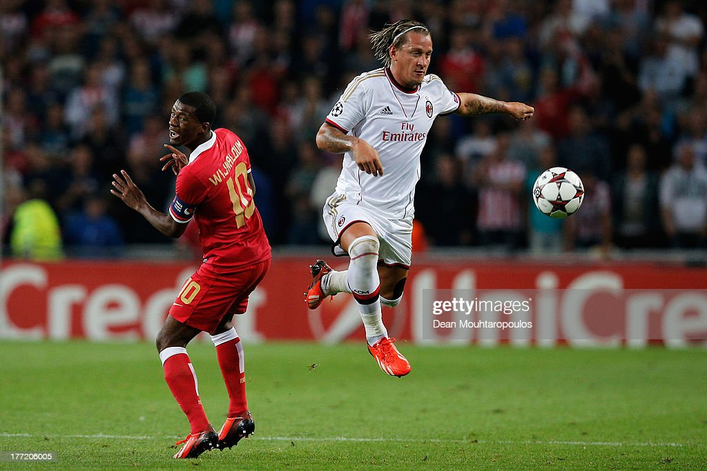 Georgino Wijnaldum of PSV and <a gi-track='captionPersonalityLinkClicked' href=/galleries/search?phrase=Philippe+Mexes&family=editorial&specificpeople=641552 ng-click='$event.stopPropagation()'>Philippe Mexes</a> of AC Milan battle for the ball during the UEFA Champions League Play-off First Leg match between PSV Eindhoven and AC Milan at PSV Stadion on August 20, 2013 in Eindhoven, Netherlands.