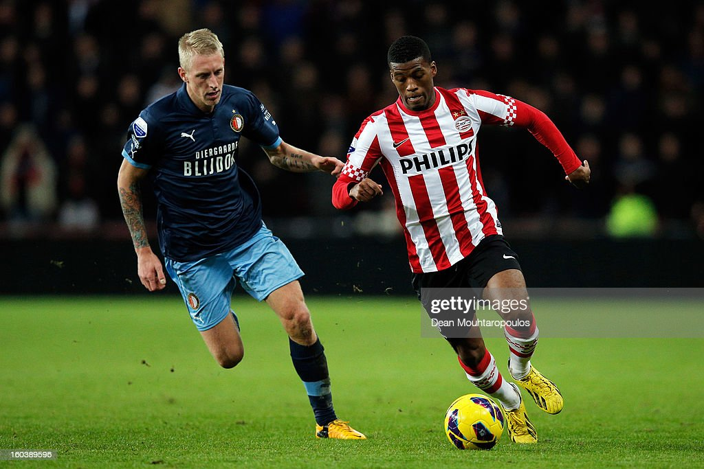 Georgino Wijnaldum (R) of PSV gets past Lex Immers of Feyenoord during the KNVB Dutch Cup match between PSV Eindhoven and Feyenoord Rotterdam at Philips Stadion on January 30, 2013 in Eindhoven, Netherlands.