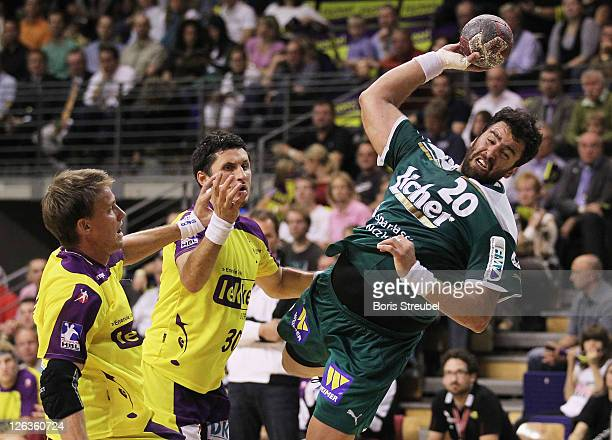 Georgios Chalkidis of Wetzlar and Torsten Laen and Alexander Petersson of Berlin compete for the ball during the Toyota Handball Bundesliga match...