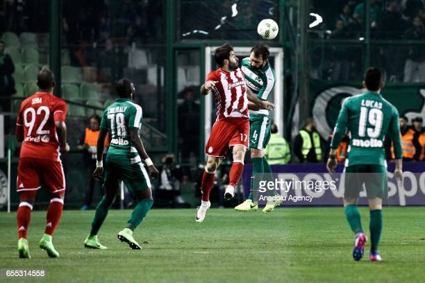 Georgios Koutroubis of Panathinaikos in action against Karim Ansarifard of Olympiacos during Superleague Greece match between Panathinaikos and...