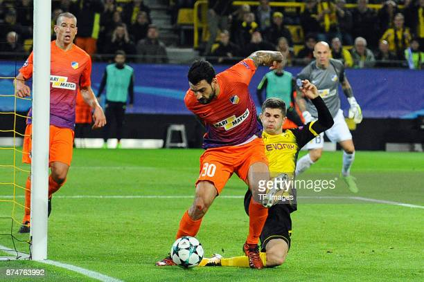 Georgios Merkis of Nikosia and Christian Pulisic of Dortmund battle for the ball during the UEFA Champions League Group H soccer match between...