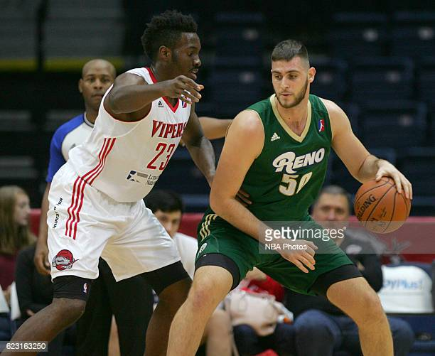 Georgios Papagiannis of the Reno Bighorns tries to get past Chinanu Onuaku of the Rio Grande Valley Vipers during the first quarter of their game at...
