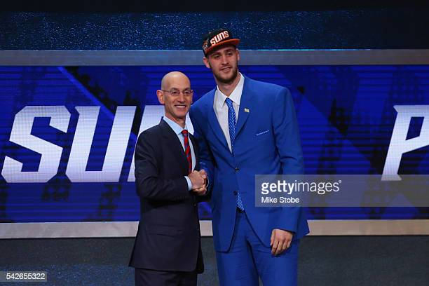 Georgios Papagiannis poses with Commissioner Adam Silver after being drafted 13th overall by the Phoenix Suns in the first round of the 2016 NBA...