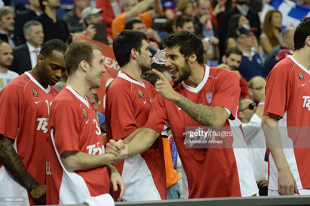 Georgios Printezis, #15 of Olympiacos Piraeus celebrates reaching the title game with a teammate at O2 Arena on May 10, 2013 in London, United Kingdom.