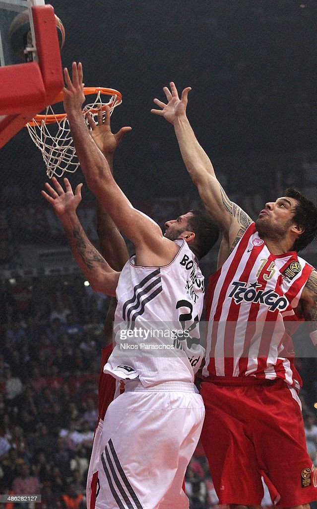 Georgios Printezis, #15 of Olympiacos Piraeus competes with <a gi-track='captionPersonalityLinkClicked' href=/galleries/search?phrase=Ioannis+Bourousis&family=editorial&specificpeople=2114420 ng-click='$event.stopPropagation()'>Ioannis Bourousis</a>, #30 of Real Madrid during the Turkish Airlines Euroleague Basketball Play Off Game 4 between Olympiacos Piraeus v Real Madrid at Peace and Friendship Stadium on April 23, 2014 in Athens, Greece.