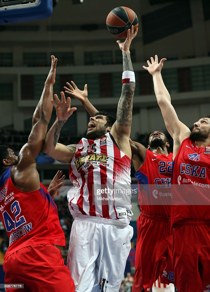 Georgios Printezis, #15 of Olympiacos Piraeus competes with Kyle Hines, #42 and Nikita Kurbanov, 41 of CSKA Moscow in action during the Turkish Airlines Euroleague Basketball Top 16 Round 7 game between CSKA Moscow v Olympiacos Piraeus at Megasport Arena on February 12, 2016 in Moscow, Russia.