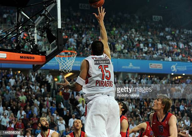 Georgios Printezis #15 of Olympiacos Piraeus scores the winning basket during the Turkish Airlines EuroLeague Final Four Final match between CSKA...