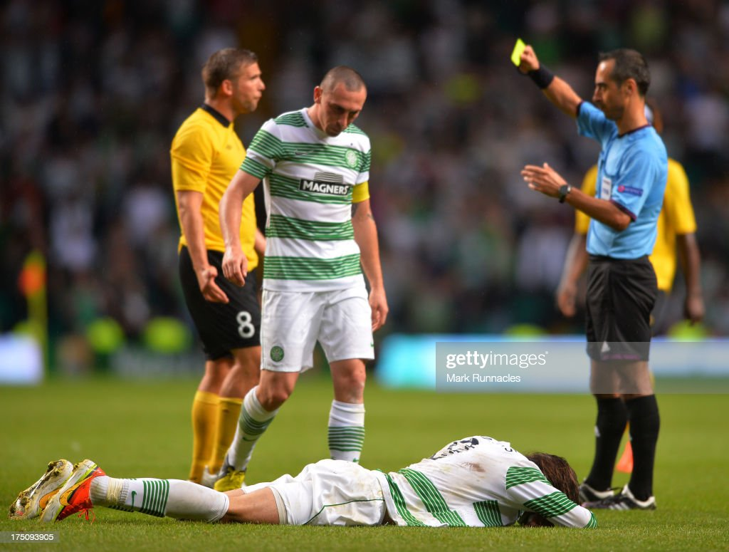 <a gi-track='captionPersonalityLinkClicked' href=/galleries/search?phrase=Georgios+Samaras&family=editorial&specificpeople=616608 ng-click='$event.stopPropagation()'>Georgios Samaras</a> of Celtic lies on the ground after a tackle by <a gi-track='captionPersonalityLinkClicked' href=/galleries/search?phrase=Anders+Svensson&family=editorial&specificpeople=167083 ng-click='$event.stopPropagation()'>Anders Svensson</a> of Elfsborg who received a yellow card for the challenge during the UEFA Champions League Third Qualifying Round First Leg match between Celtic and Elfsborg at Celtic Park Stadium on July 31, 2013 in Glasgow, Scotland.