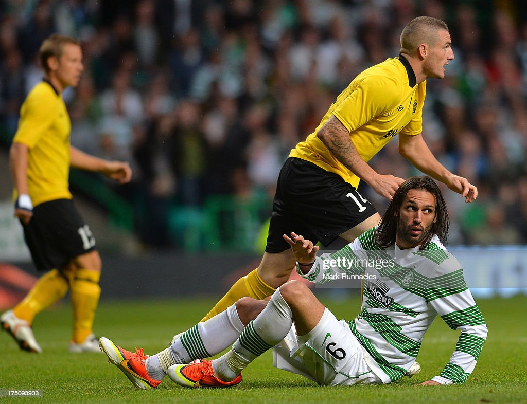 <a gi-track='captionPersonalityLinkClicked' href=/galleries/search?phrase=Georgios+Samaras&family=editorial&specificpeople=616608 ng-click='$event.stopPropagation()'>Georgios Samaras</a> of Celtic looks for a free kick after a stiff challenge during the UEFA Champions League Third Qualifying Round First Leg match between Celtic and Elfsborg at Celtic Park Stadium on July 31, 2013 in Glasgow, Scotland.