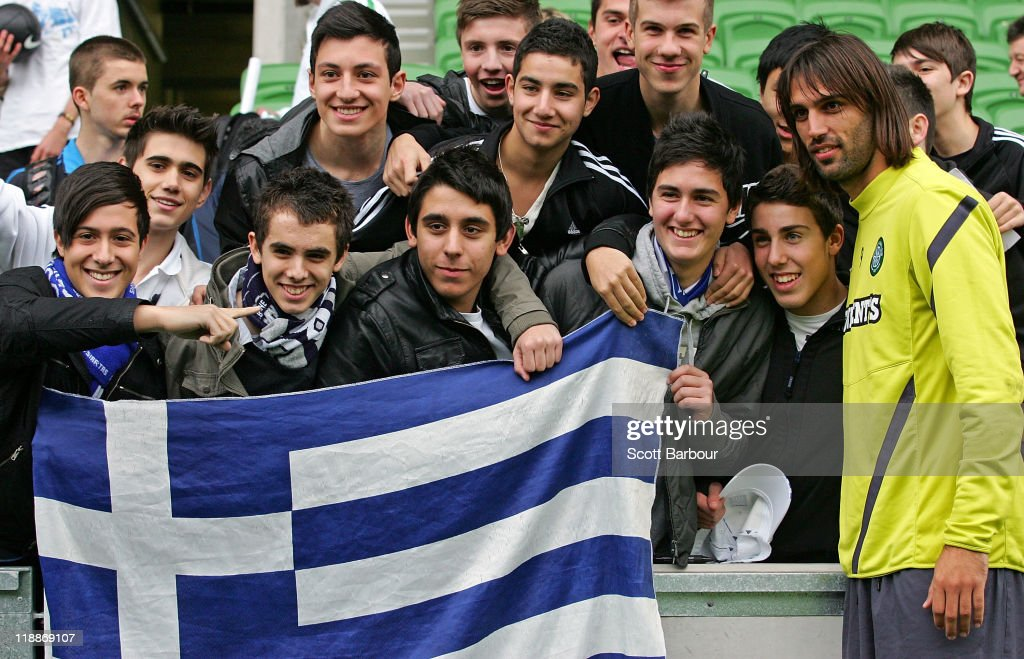 Georgios Samaras (R) of Celtic poses for a photograph with supporters during a Glasgow Celtic training session at AAMI Park on July 12, 2011 in Melbourne, Australia.